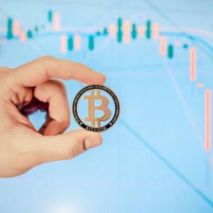 Bitcoin briefly reaches above $7,000 as stock markets rally.